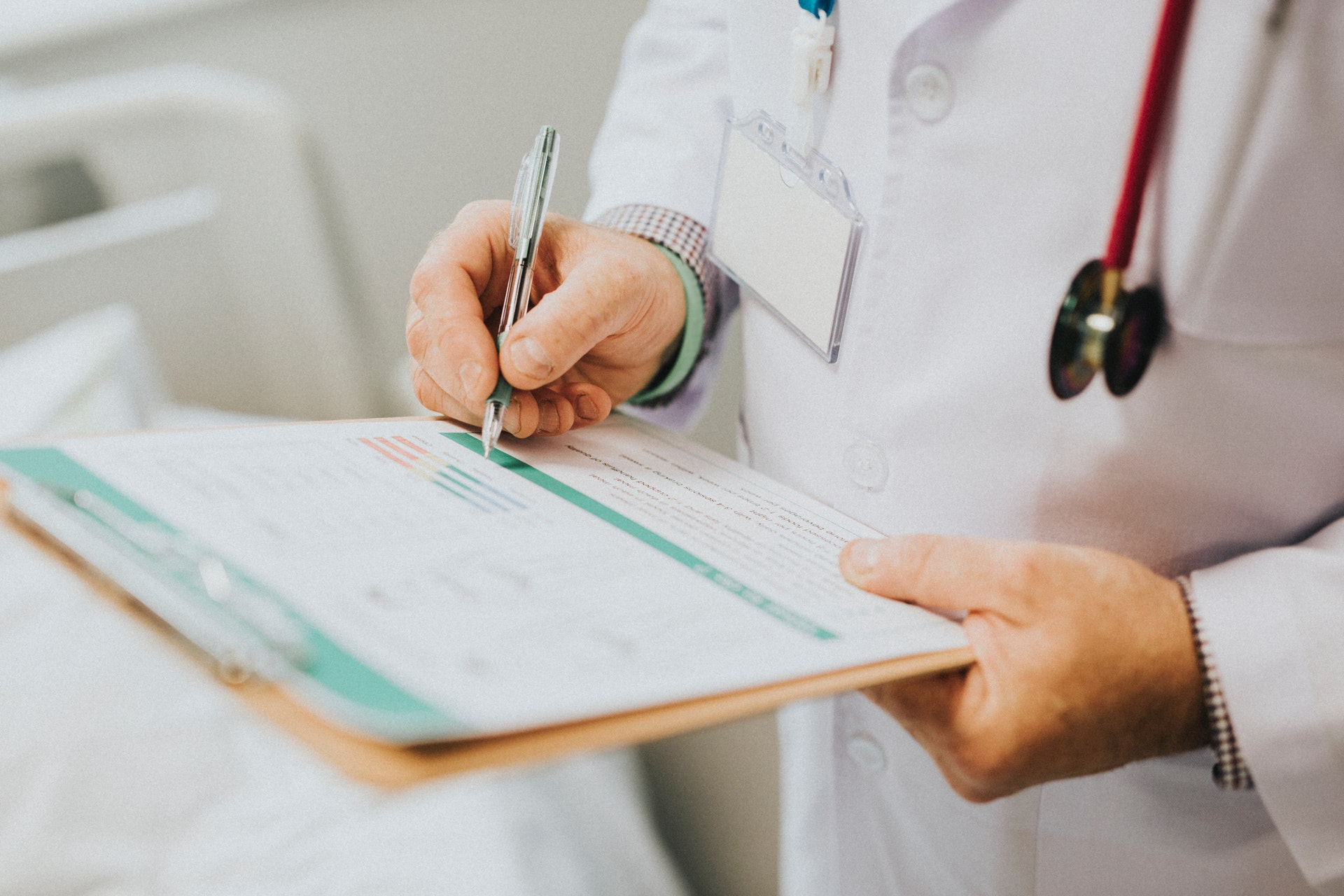 doctor holding clip board taking personal info